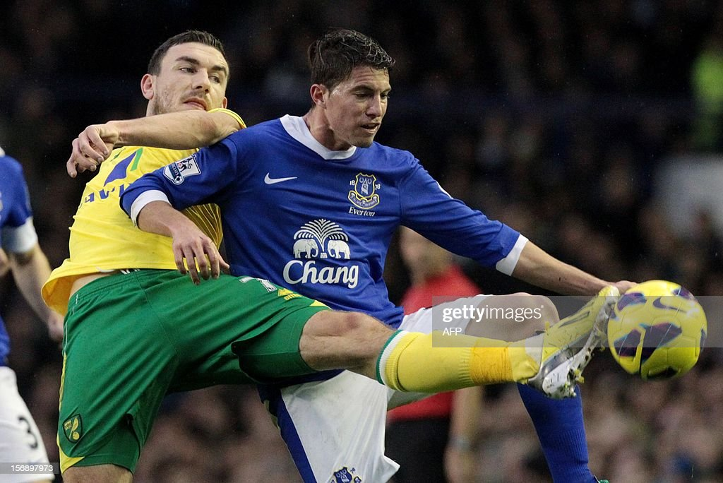 """Everton's Bryan Oviedo (R) tackles Norwich City's Robert Snodgrass during the English Premiership League football match between Everton FC and Norwich City FC at the Goodison Park stadium in Liverpool, north west England on November 24, 2012. USE. No use with unauthorized audio, video, data, fixture lists, club/league logos or """"live"""" services. Online in-match use limited to 45 images, no video emulation. No use in betting, games or single club/league/player publications."""