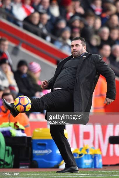 Everton's caretaker manager David Unsworth controls the ball on the touchline during the English Premier League football match between Southampton...