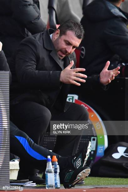 Everton's caretaker manager David Unsworth gestures in his seat during the English Premier League football match between Southampton and Everton at...