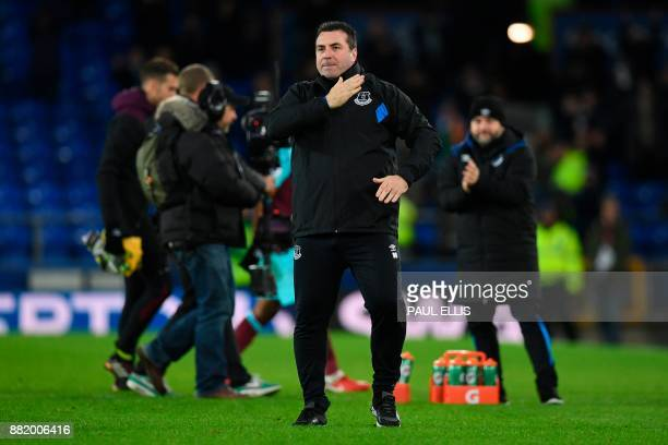 Everton's caretaker manager David Unsworth gestures on the pitch after the English Premier League football match between Everton and West Ham United...