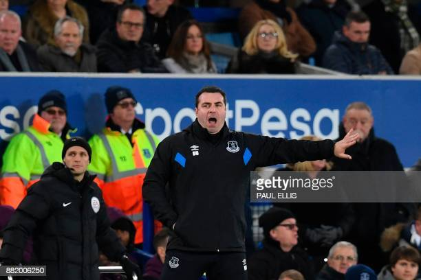 Everton's caretaker manager David Unsworth gestures on the touchline during the English Premier League football match between Everton and West Ham...