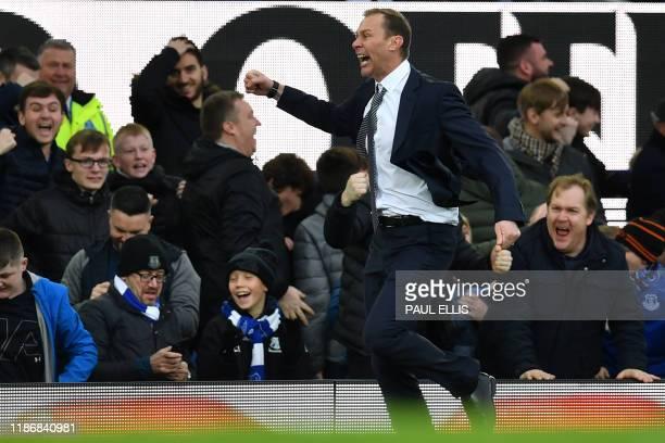 TOPSHOT Everton's caretaker manager Duncan Ferguson celebrates on the touchline after Everton's English striker Dominic CalvertLewin makes the score...