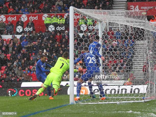 Everton's Cenk Tosun scores his sides first goal beating Stoke City's Jack Butland during the Premier League match between Stoke City and Everton at...