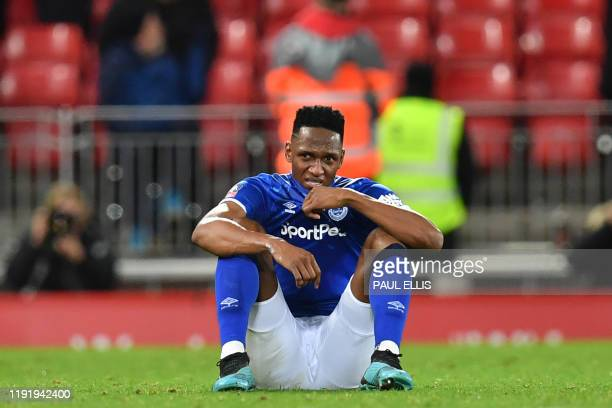 Everton's Colombian defender Yerry Mina reacts to their defeat on the pitch after the English FA Cup third round football match between Liverpool and...