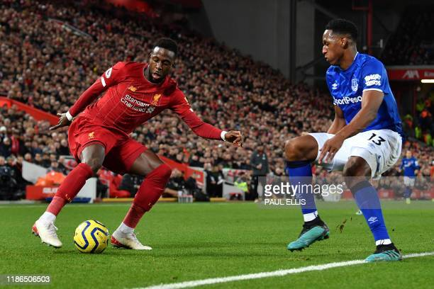 Everton's Colombian defender Yerry Mina vies with Liverpool's Belgium striker Divock Origi during the English Premier League football match between...