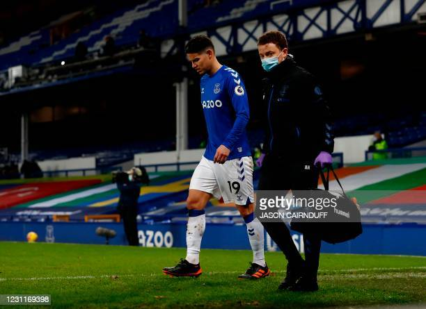 Everton's Colombian midfielder James Rodriguez leaves the pitch injured during the English Premier League football match between Everton and Fulham...