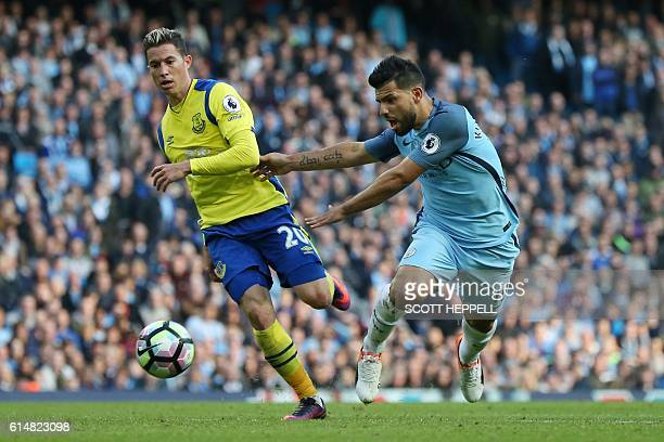 Everton's Costa Rican midfielder Bryan Oviedo vies with Manchester City's Argentinian striker Sergio Aguero during the English Premier League...