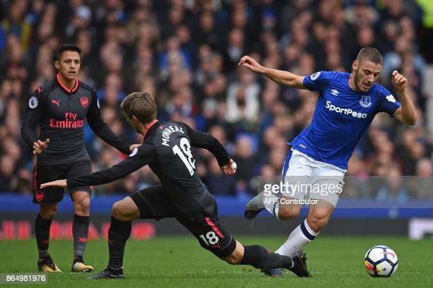 Everton's Croatian striker Nikola Vlasic takes on Arsenal's Spanish defender Nacho Monreal during the English Premier League football match between...