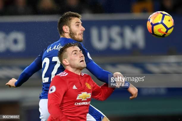 Everton's Croatian striker Nikola Vlasic vies with Manchester United's English defender Luke Shaw during the English Premier League football match...