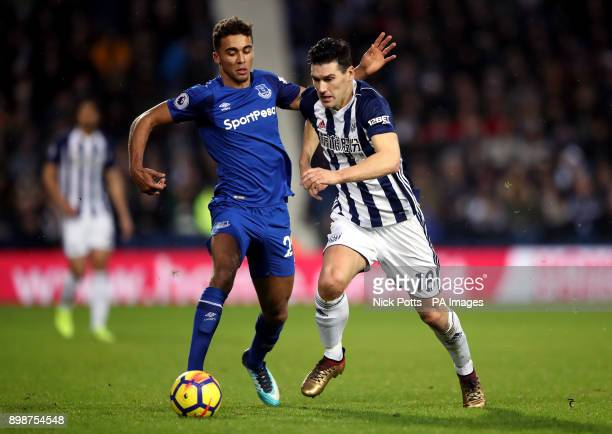 Everton's Dominic CalvertLewin and West Bromwich Albion's Gareth Barry battle for the ball during the Premier League match at The Hawthorns West...