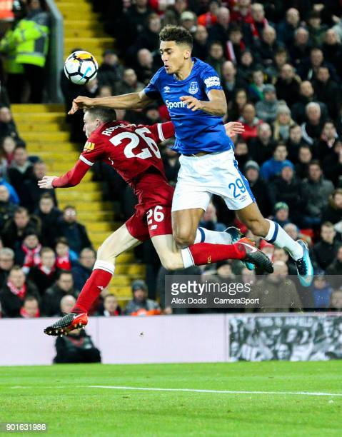 Everton's Dominic CalvertLewin battles in the air with Liverpool's Andrew Robertson during the Emirates FA Cup Third Round match between Liverpool...