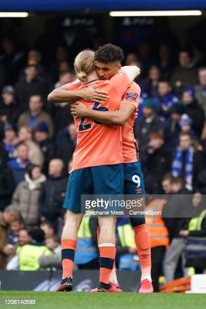 Everton's Dominic Calvert-Lewin embraces teammate Tom Davies prior to kick off during the Premier League match between Chelsea FC and Everton FC at...