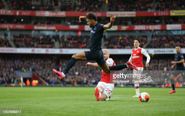 Everton's Dominic CalvertLewin is challenged by Arsenal's Shkodran Mustafi during the Premier League match between Arsenal FC and Everton FC at...