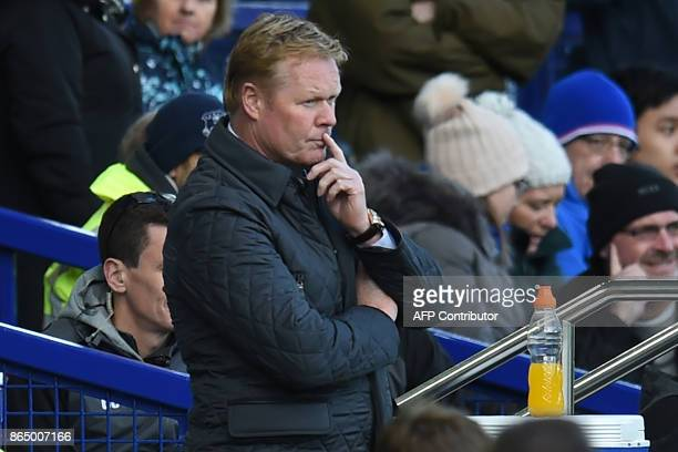 Everton's Dutch manager Ronald Koeman looks on after Arsenal score their fourth goal during the English Premier League football match between Everton...
