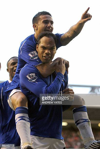 Everton's English defender Joleon Lescott celebrates with Everton's Australian midfielder Tim Cahill after scoring the opening goal during the FA Cup...