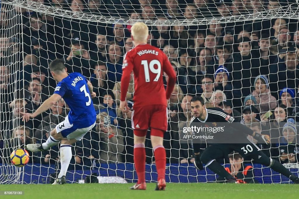 Everton's English defender Leighton Baines (L) scores their third goal from the penalty spot past substitute goalkeeper Orestis Karnezis (R) during the English Premier League football match between Everton and Watford at Goodison Park in Liverpool, north west England on November 5, 2017. / AFP PHOTO / Lindsey PARNABY / RESTRICTED TO EDITORIAL USE. No use with unauthorized audio, video, data, fixture lists, club/league logos or 'live' services. Online in-match use limited to 75 images, no video emulation. No use in betting, games or single club/league/player publications. /