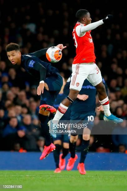 Everton's English defender Mason Holgate leaps against Arsenal's English striker Eddie Nketiah during the English Premier League football match...