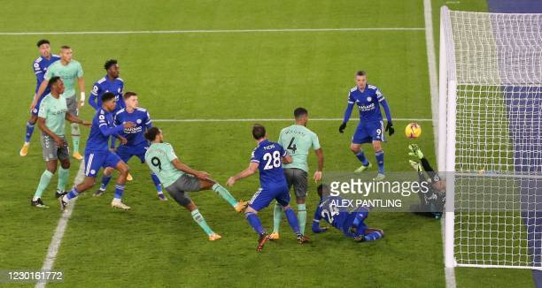 Everton's English defender Mason Holgate scores his team's second goal during the English Premier League football match between Leicester City and...