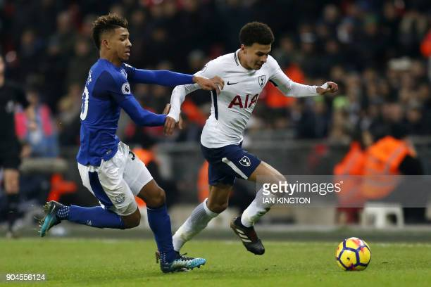 Everton's English defender Mason Holgate vies with Tottenham Hotspur's English midfielder Dele Alli during the English Premier League football match...