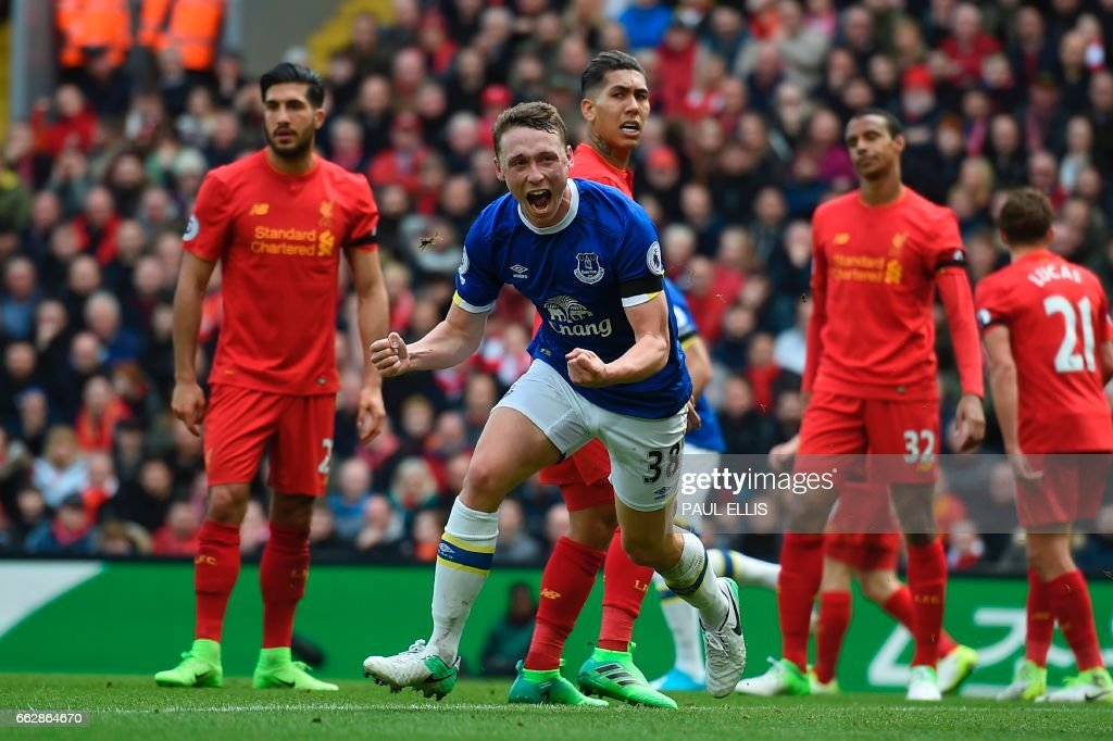 TOPSHOT - Everton's English defender Matthew Pennington (2nd L) celebrates after scoring their first goal during the English Premier League football match between Liverpool and Everton at Anfield in Liverpool, north west England on April 1, 2017. / AFP PHOTO / PAUL ELLIS / RESTRICTED TO EDITORIAL USE. No use with unauthorized audio, video, data, fixture lists, club/league logos or 'live' services. Online in-match use limited to 75 images, no video emulation. No use in betting, games or single club/league/player publications. /