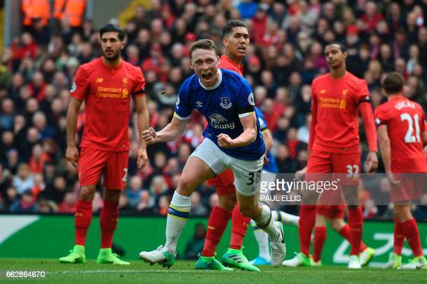 TOPSHOT Everton's English defender Matthew Pennington celebrates after scoring their first goal during the English Premier League football match...