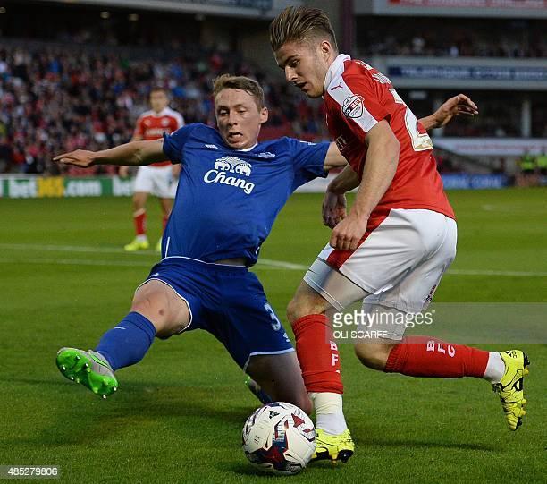 Everton's English defender Matthew Pennington vies with Barnsley's English midfielder Daniel Crowley during the English League Cup football match...