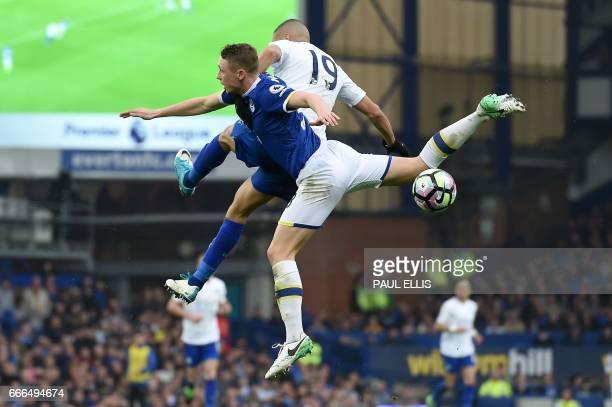 Everton's English defender Matthew Pennington vies with Leicester City's Algerian striker Islam Slimani during the English Premier League football...