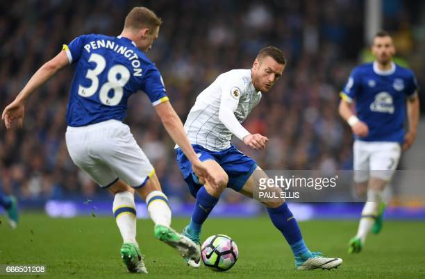 Everton's English defender Matthew Pennington vies with Leicester City's English striker Jamie Vardy during the English Premier League football match...