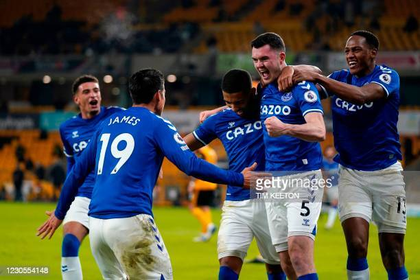 Everton's English defender Michael Keane celebrates scoring his team's second goal during the English Premier League football match between...