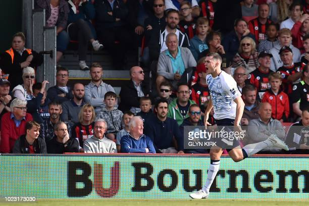 Everton's English defender Michael Keane celebrates scoring their second goal during the English Premier League football match between Bournemouth...