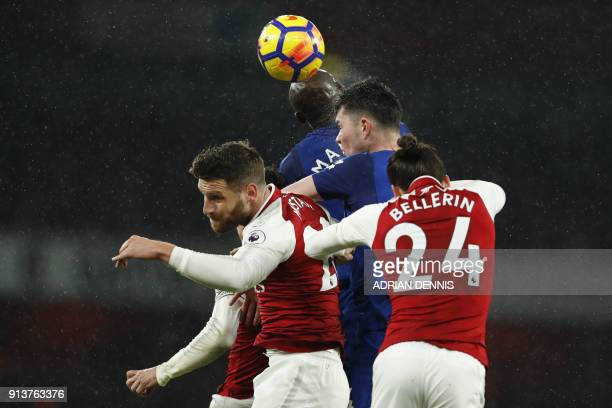 Everton's English defender Michael Keane heads a free kick towards goal during the English Premier League football match between Arsenal and Everton...