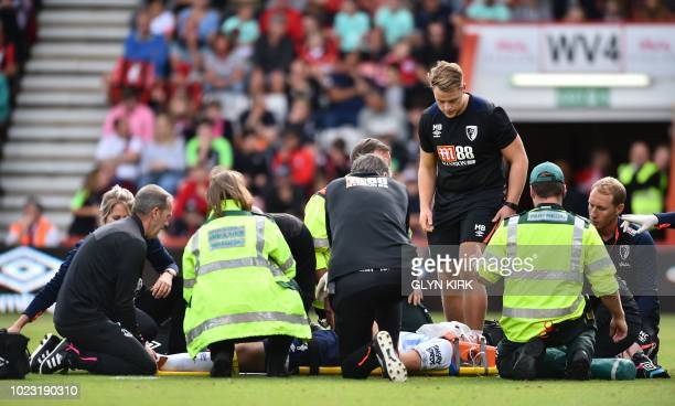 Everton's English defender Michael Keane is stretchered off after getting injured during the English Premier League football match between...