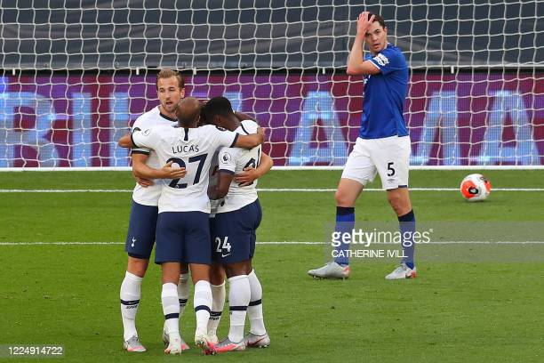 Everton's English defender Michael Keane reacts after conceding the opening goal as Tottenham Hotspur's Argentinian midfielder Giovani Lo Celso is...