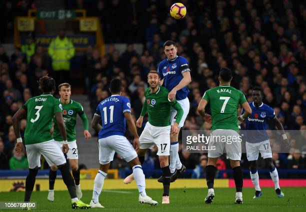Everton's English defender Michael Keane vies ti head the ball with Brighton's English striker Glenn Murray during the English Premier League...