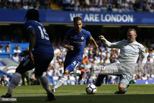 Everton's English defender Michael Keane vies with Everton's English striker Wayne Rooney during the English Premier League football match between...