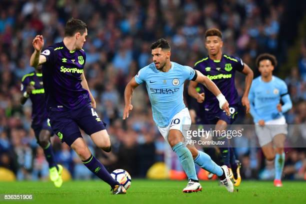 Everton's English defender Michael Keane vies with Manchester City's Argentinian striker Sergio Aguero during the English Premier League football...