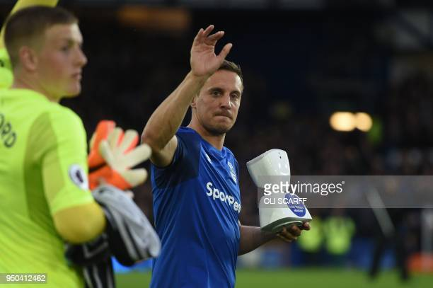 Everton's English defender Phil Jagielka holds an AV1 telepresence robot allowing teenage fan Jack McLinden to be a 'virtual matchday mascot' ahead...