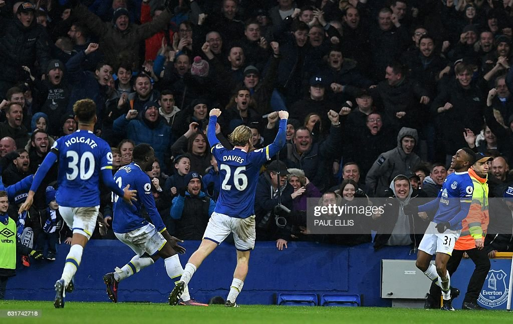 Everton's English forward Ademola Lookman (R) celebrates scoring his team's fourth goal during the English Premier League football match between Everton and Manchester City at Goodison Park in Liverpool, north-west England on January 15, 2017. Everton won the match 4-0. / AFP / Paul ELLIS / RESTRICTED TO EDITORIAL USE. No use with unauthorized audio, video, data, fixture lists, club/league logos or 'live' services. Online in-match use limited to 75 images, no video emulation. No use in betting, games or single club/league/player publications. /
