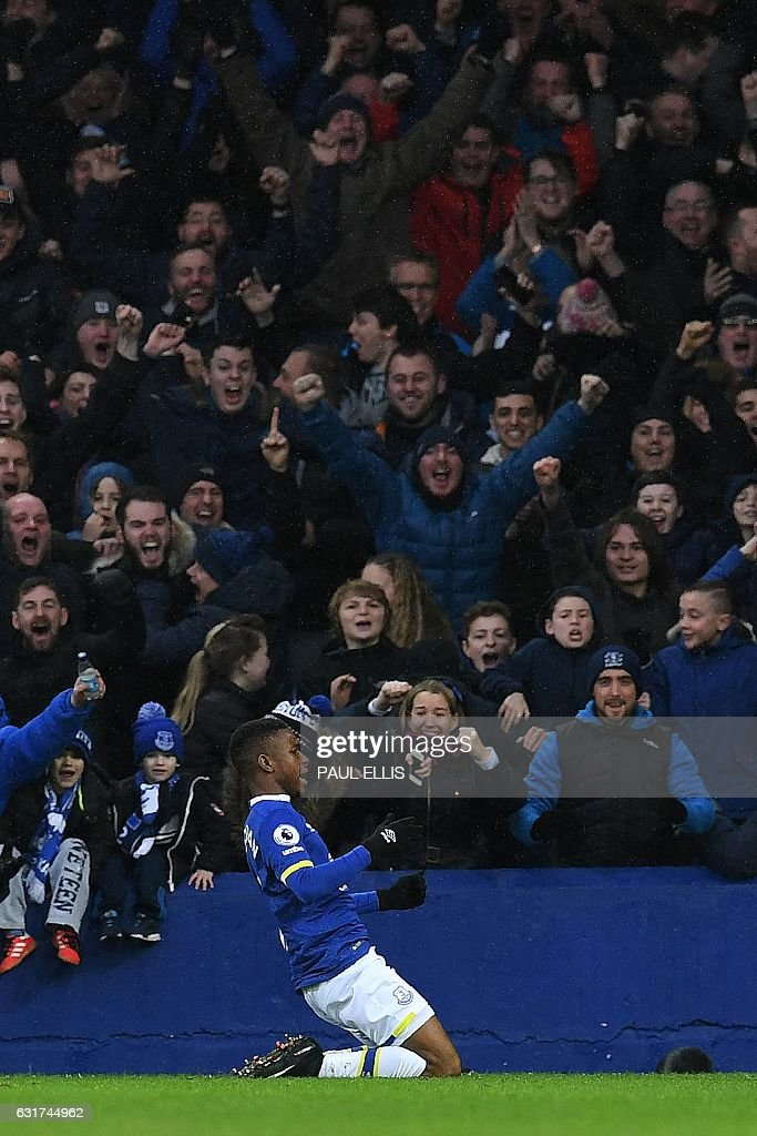 Everton's English forward Ademola Lookman celebrates scoring his team's fourth goal during the English Premier League football match between Everton and Manchester City at Goodison Park in Liverpool, north-west England on January 15, 2017. Everton won the match 4-0. / AFP / Paul ELLIS / RESTRICTED TO EDITORIAL USE. No use with unauthorized audio, video, data, fixture lists, club/league logos or 'live' services. Online in-match use limited to 75 images, no video emulation. No use in betting, games or single club/league/player publications. /