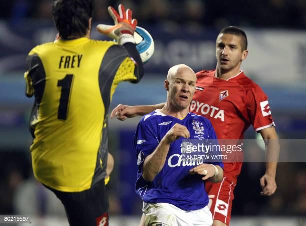 Everton's English forward Andrew Johnson is denied by Fiorentina's French goalkeeper Sebastien Frey and Fiorentina's Italian defender Alessandro...