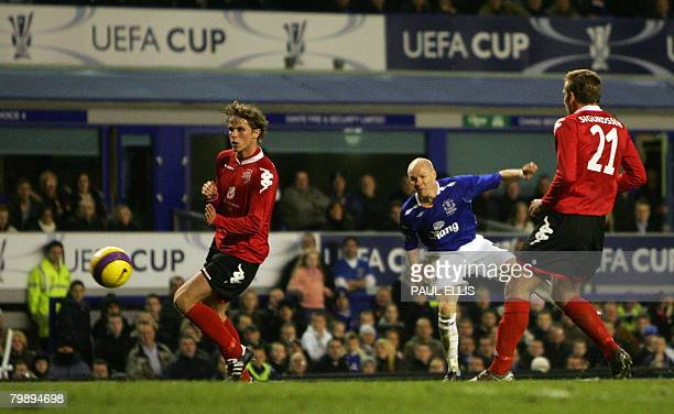 Everton's English forward Andrew Johnson scores against SK Brann during their UEFA Cup football match at Goodison Park Liverpool northwest England...