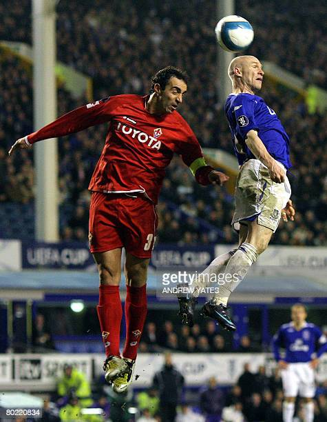 Everton's English forward Andrew Johnson wins a header from Fiorentina's Italian defender Dario Dainelli during the UEFA Cup Fourth Round Second Leg...