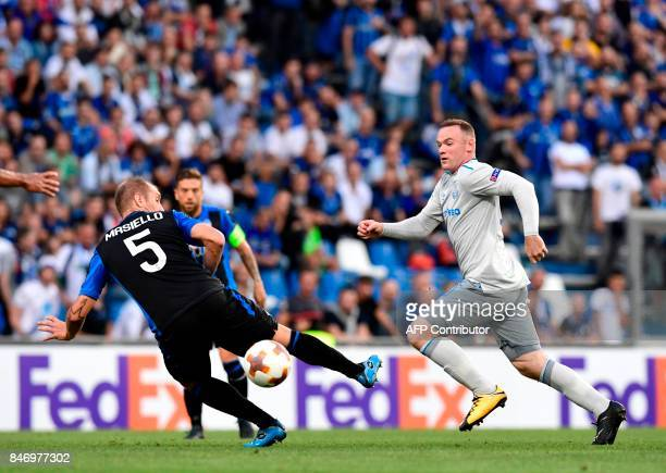 Everton's English forward Wayne Rooney fights for the ball with Atalanta's Italian defender Andrea Masiello during the UEFA Europa League Group E...