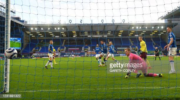 Everton's English goalkeeper Jordan Pickford conceeds the first goal during the English Premier League football match between Everton and Burnley at...