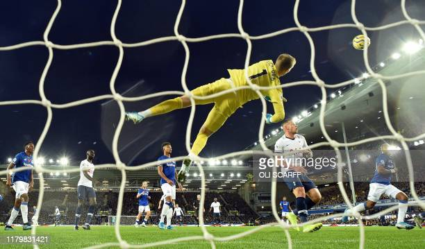 TOPSHOT Everton's English goalkeeper Jordan Pickford dives to make save during the English Premier League football match between Everton and...