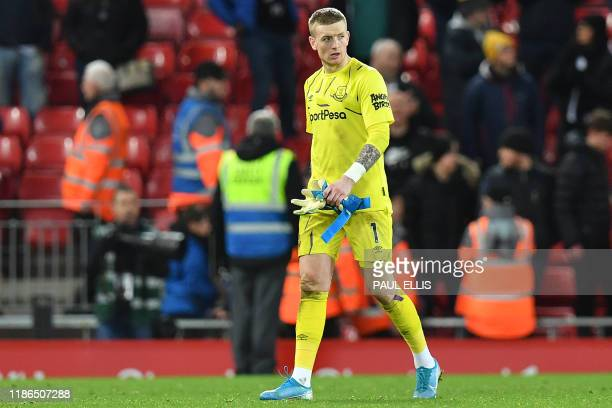 Everton's English goalkeeper Jordan Pickford leaves the pitch after the English Premier League football match between Liverpool and Everton at...