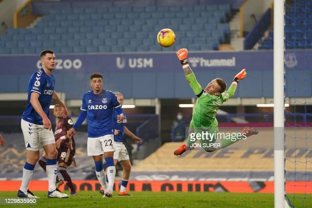 Everton's English goalkeeper Jordan Pickford makes a save from Leeds United's Brazilian midfielder Raphinha during the English Premier League...
