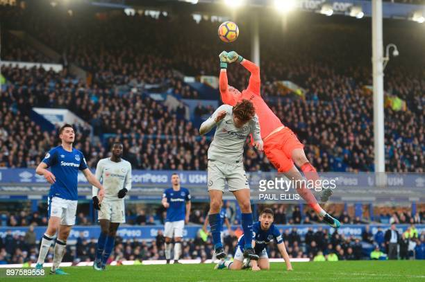 Everton's English goalkeeper Jordan Pickford makes save under pressure from Chelsea's Spanish defender Marcos Alonso during the English Premier...