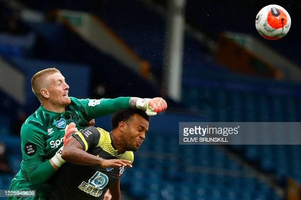 Everton's English goalkeeper Jordan Pickford punches the ball away from Southampton's English defender Ryan Bertrand during the English Premier...