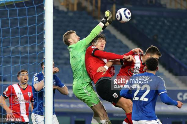 Everton's English goalkeeper Jordan Pickford punches the ball clear during the English Premier League football match between Everton and Southampton...